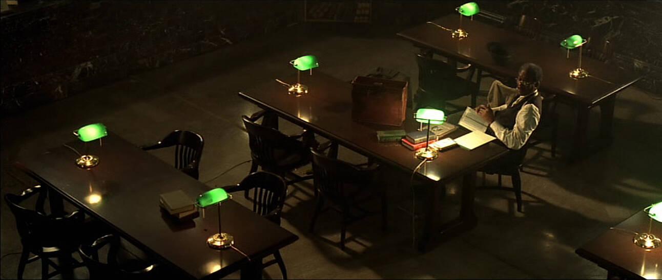 scene from the movie se7en with morgan freeman reading books.jpg